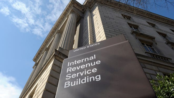 In this photo March 22, 2013 file photo, the exterior of the Internal Revenue Service (IRS) building in Washington. Congressional Republicans are planning a massive overhaul of the nation's tax system in 2017, a heavy political lift that could ultimately affect families at every income level and businesses of every size.