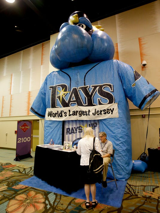 Baseball jerseys for every team, including the worlds largest, were on display at a trade show at the Major League Baseball winter meetings Wednesday, Dec. 13, 2017, in Orlando, Fla. (AP Photo/John Raoux)