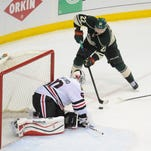 Minnesota Wild right wing Nino Niederreiter shoots against Chicago Blackhawks goalie Corey Crawford in the third period of game six of the second round of the 2014 Stanley Cup Playoffs at Xcel Energy Center.