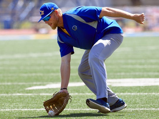 Texas A&M-Kingsville's Jimmy Roche reaches for the