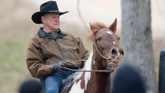 Roy Moore, Republican senate nominee, rides a horse