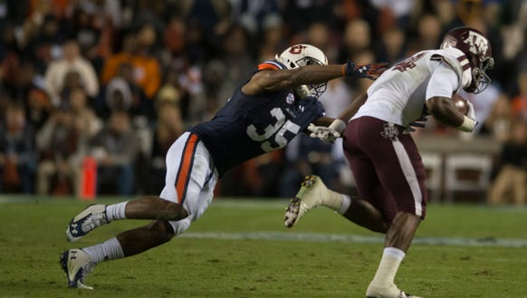 Auburn defensive back Jermaine Whitehead (35) attempts