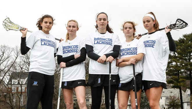 Bronxville girls lacrosse seniors, from left, Beth Finley, Mason Warble, Olivia Jensen, Ellie Walsh and Lucy Hanrahan, photographed on Saturday, April 1, 2017. Bronxville is the 3-time defending Section 1 Champions.