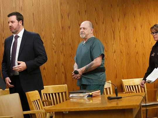 Dennis Brantner (middle) is led into court with his attorney Craig Powell during his hearing for a re-trial for the murder of Berit Beck.