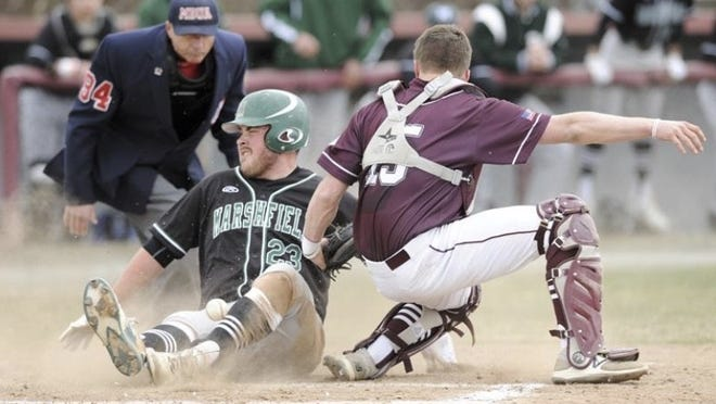 Patrick Stanton slides across the plate with a run for the Marshfeld Rams.
