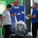 Passengers get their luggage wrapped in plastic protection wrap in Manila airport on Nov. 4, 2015. The Philippine government said Nov. 4 it was investigating claims of a major extortion racket at the nation's main airport involving security personnel planting bullets in passengers' luggage.