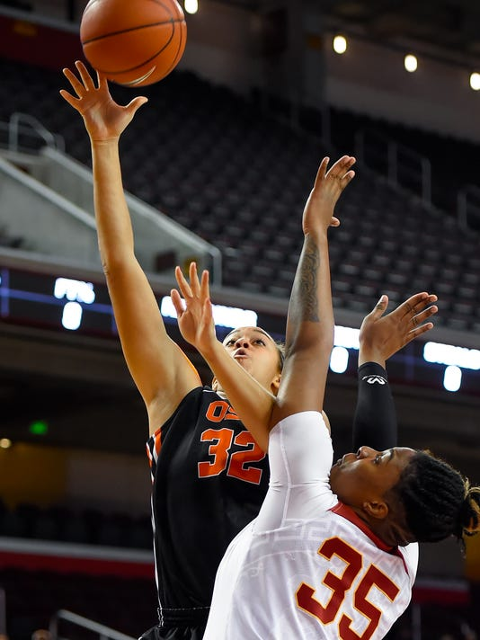 Oregon State forward Deven Hunter (32) shoots over Southern California forward Kristen Simon (35) for a basket during the first half of an NCAA college basketball game Saturday, Jan. 2, 2016, in Los Angeles. (AP Photo/Gus Ruelas)