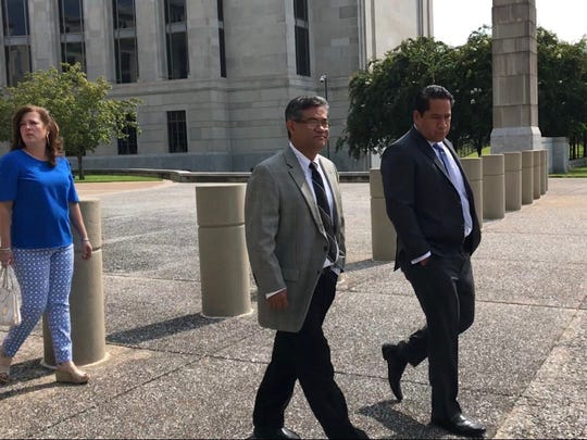 Dr. Gilberto Sanchez leaves federal court on Thursday, Aug. 23, after a judge sentenced him to more than 12 years in prison.