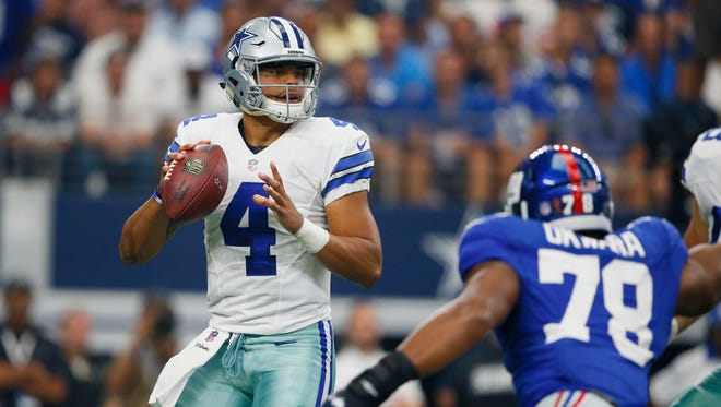 Dallas Cowboys quarterback Dak Prescott (4) throws against the New York Giants at AT&T Stadium.