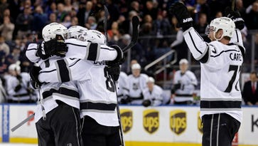 The Los Angeles Kings celebrate a goal scored by Anze