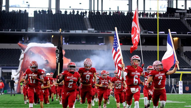 Sweetwater players take the field before the Class 4A Div. II state championship game on Friday, Dec. 16, 2016, at AT&T Stadium in Arlington.