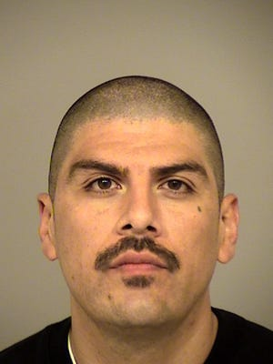 Alex Flores, 34, of Thousand Oaks, was arrested Feb. 15 on suspicion of felony first-degree residential robbery and conspiracy to commit a crime.