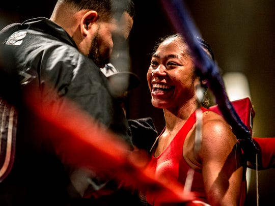 Alycia Baumgardner smiles after winning her pro debut in the first round with a TKO of Britain Hart March 4 in Columbus.