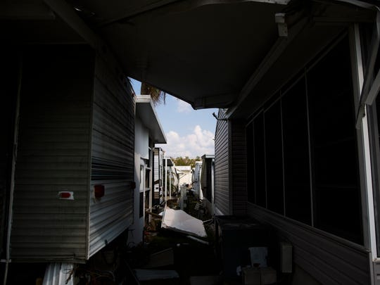 Debris from Hurricane Irma sits in between trailers in Fisherman's Cove on Thursday, September 21, 2017 in Everglades City.