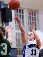 Western Mennonite's Maddie Hopper (11) shoots the ball in the Regis vs. Western Mennonite girl's basketball game at Western Mennonite High School on Wednesday, Feb. 17, 2016.
