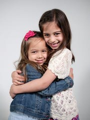 Mila Dorogi, left, 4, of Novi, and her sister, Avery