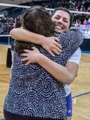 Jill Pyles hugs coach Jean LaClair at center court