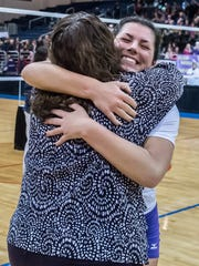 Jill Pyles hugs coach Jean LaClair at center court after Bronson won the 2016 Class C State Volleyball Championship at Kellogg Arena.