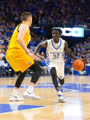 Kentucky's Wenyen Gabriel (32) drives past the defender during the game between the Valparaiso Crusaders and the Kentucky Wildcats.