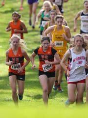 York Suburban's Zette Pflum, left, and teammate Courtney Ohl, middle, climb a hill during the District 3 Class 2A championship.