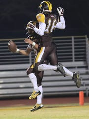 Golden West's Kai Caudell and Josiah Washington celebrate after a touchdown during a 2017 CIF State Regional Football Championship Bowl Game with Big Bear at Visalia Community Stadium on Dec 8, 2017.