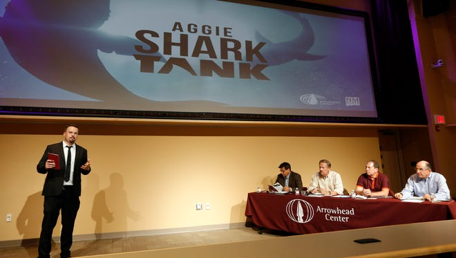 Kramer Winingham, Program Manager of NMSU Arrowhead Center, welcomes judges and participants to the Aggie Shark Tank event at Pete Domenici Hall on  Aug. 12.
