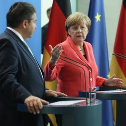 German Chancellor Angela Merkel and Vice Chancellor and Economy and Energy Minister Sigmar Gabriel speak to the media on June 29, 2015, in Berlin following European Central Bank's announcement that it would not extend emergency funding to Greece.