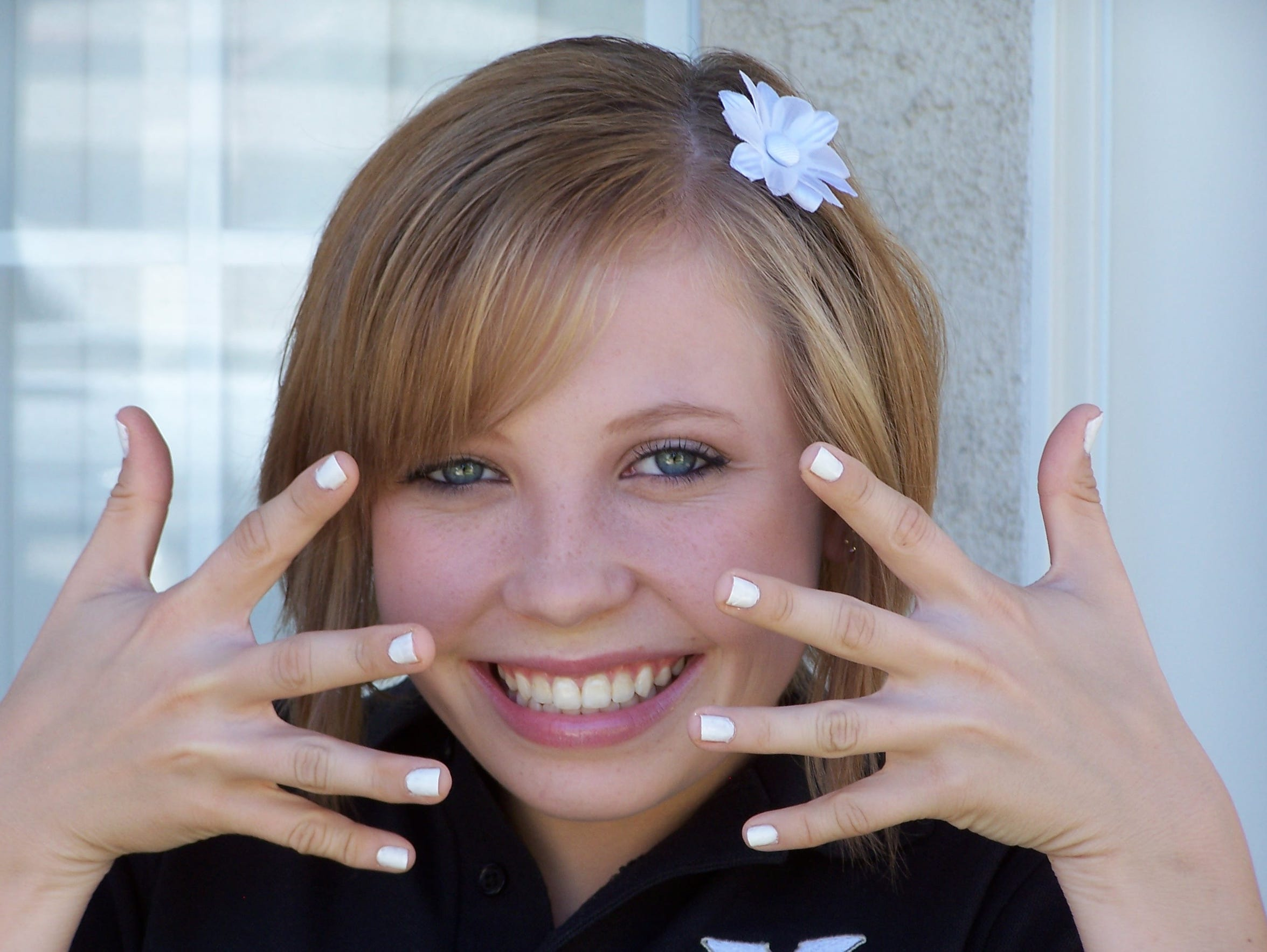 Madeline Muth shows off her freshly painted nails on