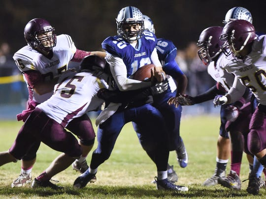 John Jay's Ryan Schumacher attempt to break away from Arlington's Ben Siebold during Friday's game in Wiccopee.