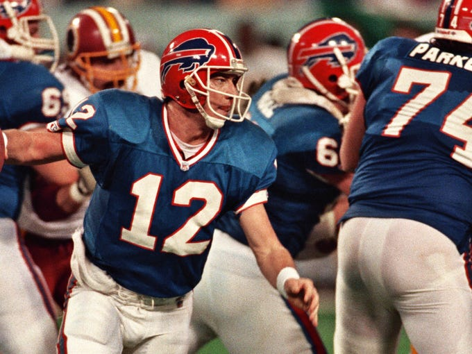 Jim Kelly looks for room in the pocket during Super Bowl XXVI against Washington.