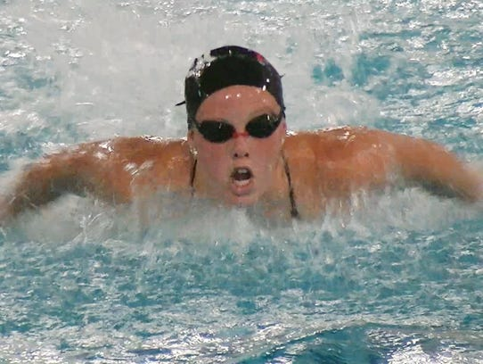 Leah Braswell of Manchester swims the butterfly during