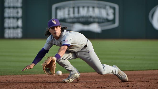 LSU's Kramer Robertson stretches trying to field a base hit in the second game of the series, April 8, 2017 in Fayetteville, Arkansas. Photo by Chris Daigle Special to the Advertiser