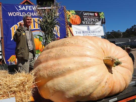 Steve Daletas of Pleasant Hill, Oregon, celebrates his first place win in the 45th annual Safeway World Championship Pumpkin Weigh-Off on Monday, Oct. 8, 2018, in Half Moon Bay, California. A commercial pilot from Oregon raised a giant pumpkin weighing 2,170 pounds (984 kilograms) to win a pumpkin-weighing contest in Northern California. Daletas credited a good seed and lots of sunny days since he planted it April 15. It is the fourth time Daletas took top honors at the annual pumpkin-weighing contest.