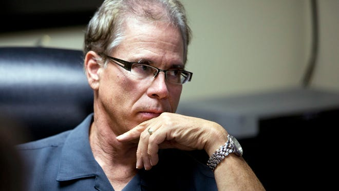 Businessman and Indiana state legislator Mike Braun listens during a Sept. 18, 2015, meeting in Jasper, Ind. Braun, a wealthy U.S. Senate candidate who bills himself in television ads as a conservative Republican, voted for more than a decade in the state's Democratic primaries, according to public documents obtained by the Associated Press.