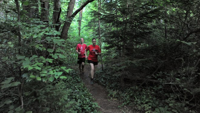 Sam and Julia Moore run the shadowy trails that wind through the Montreat College Black Mountain campus as they prepare to run the six-hour race in the Black Mountain Monster on Saturday, June 2.