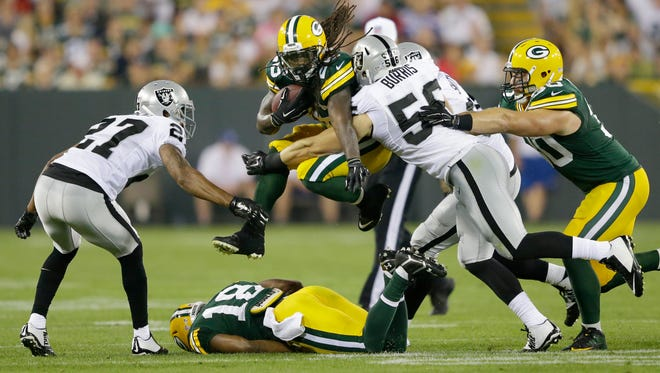 Packers running back DuJuan Harris leaps for yardage Friday night against the Raiders.