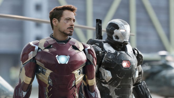 "Iron Man (Robert Downey Jr.) and War Machine (Don Cheadle) ready for a fight in ""Captain America: Civil War."""
