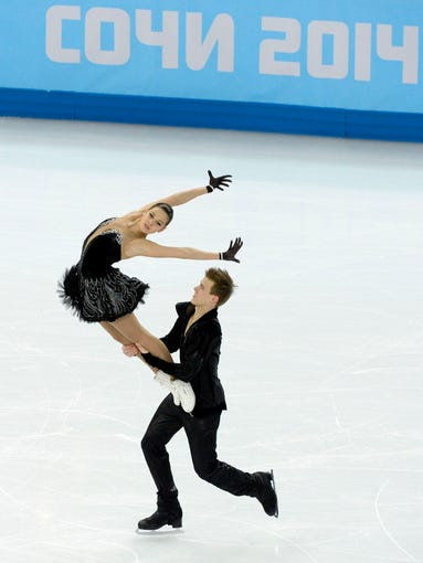 Elena Ilinykh and Nikita Katsalapov (RUS) perform in the team ice dance free dance.