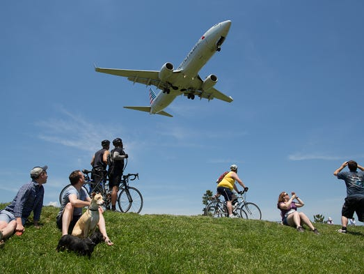 People watch planes at Gravelly Point Park, just north