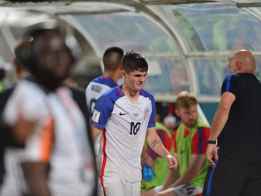 Disheartened U.S. players after being defeated by Trinidad and Tobago