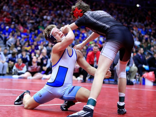 Alex Thomsen of Underwood wins the state championship at 126 pounds against Cobe Siebrecht of Lisbon in Saturday, Feb. 17, 2018.