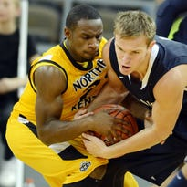 NKU's Tayler Persons (2) drives to the basket Jonathan Holton of West Virginia. Persons will be NKU's next go-to player as the Norse's seniors prepare for graduation.