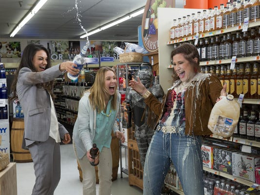 (Left to Right) MILA KUNIS as Amy Mitchell,KRISTEN BELL as Kiki,KATHRYN HAHN as Carla Dunkler.