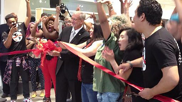 Ridgeland, Miss. Mayor Gene McGee cuts a red ribbon at the opening of an H&M store in Northpark Mall.