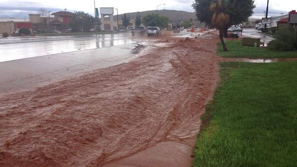 Parts of Bluff Street more closely resemble a river during the downpour experienced in the St. George area this morning.