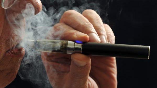 A smoker demonstrates an e-cigarette in Wichita Falls, Texas, in January.