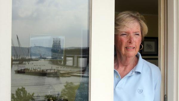Geraldine Kavanah of Tarrytown, looks out her window at the Tappan Zee bridge construction July 2, 2014. Kavanah was offered up to $30,000 from the TZ project team for sound-reducing windows and doors. She is unsure if she will accept the offer.