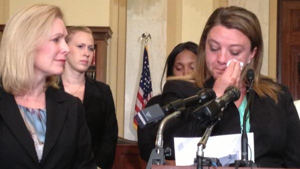 Sen. Kirsten Gillibrand listens as military sexual assault victim Jennifer Norris expresses her support for Gillibrand legislation at a Washington, D.C., news conference. The bill would give military prosecutors the authority to file charges in some cases.