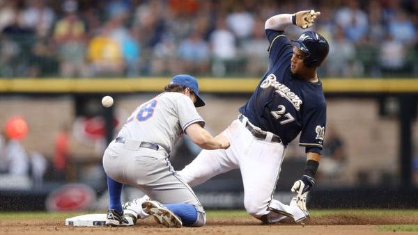 The Milwaukee Brewers' Carlos Gomez steals second base as the throw gets away from Mets second baseman Daniel Murphy on Thursday night.