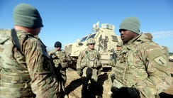 U.S. troops speaking as they train Iraq's 72nd Brigade